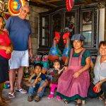 Buying Mexican Pottery in Amatenango. Three generations of one family of potters posing with Allan and Janet.