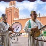 The Marrakech Medina: Wandering minstrels play Moroccan music outside our cafe. A typical andalous orchestra uses rabab (fiddle), oud (lute), kamenjah (violin-style instrument played vertically on the knee), qanun (zither), darbuka (metal or pottery goblet drums) and taarija (tambourine).