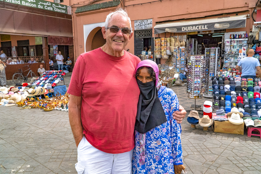 A Tour in Marrakech Gone Awry. Allan and a local lady pose for a photo in the medina. We had to pay her one USD for permission to snap her photo.