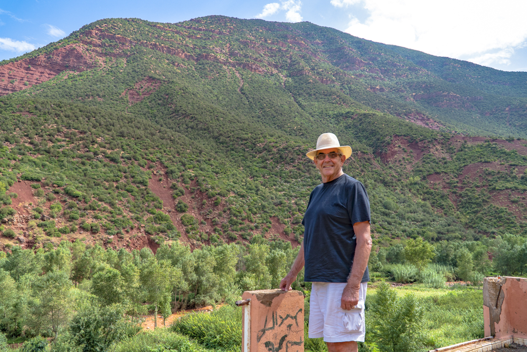 A Tour in Marrakech Gone Awry. Allan stands in front of the Atlas mountains during our second stop at the tourist trap. Other guides brought guests over here for photos. Our did nothing but drink tea and avoid us.