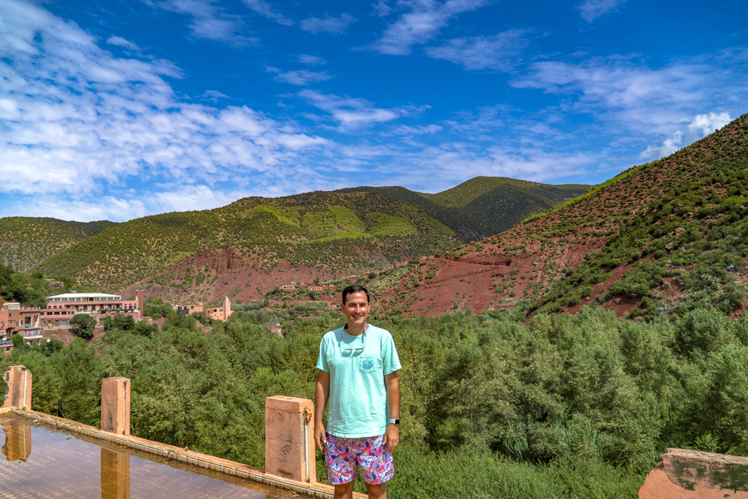 A Tour in Marrakech Gone Awry. Behind me stands the Atlas Mountains, and below a mud filled river winds near the second tourist trap on our trip.
