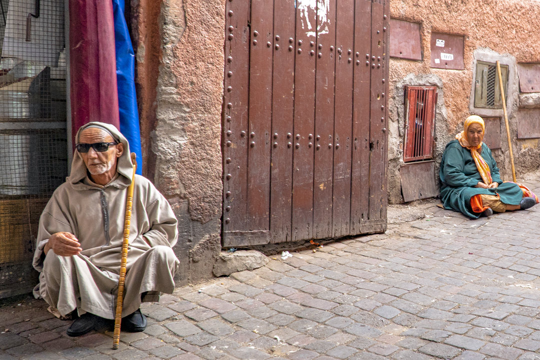 A Tour in Marrakech Gone Awry. Beggars outside the Koutoubia Mosque. Built in 1158 by the Almohad Caliph Abd al-Mu'min (1094–1163), it was then completed by his grandson the Almoravid Sultan Yacoub El Mansour in 1195.