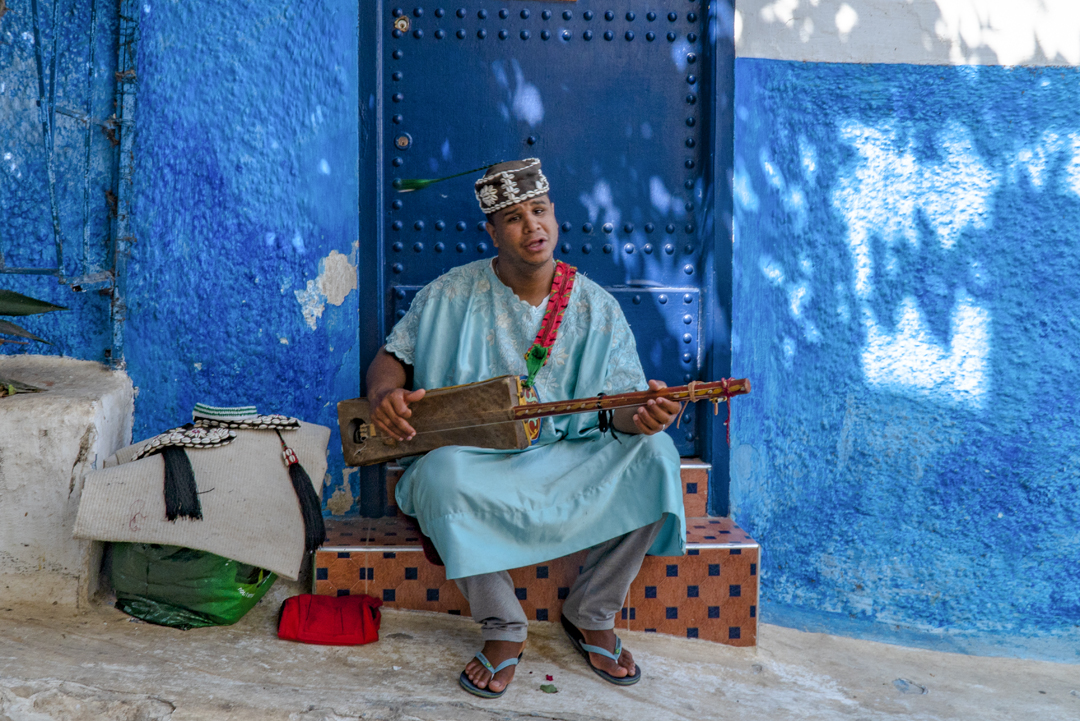 My Top Travel Tips for Morocco. This minstrel in the medina in Rabat shook his head from side to side so the tassel on the top bounced about.