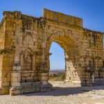 Nine Photos of Volubilis: Volubilis covers roughly 42 hectares (100 acres) with a 2.6 km (1.6 mi) area of walls.