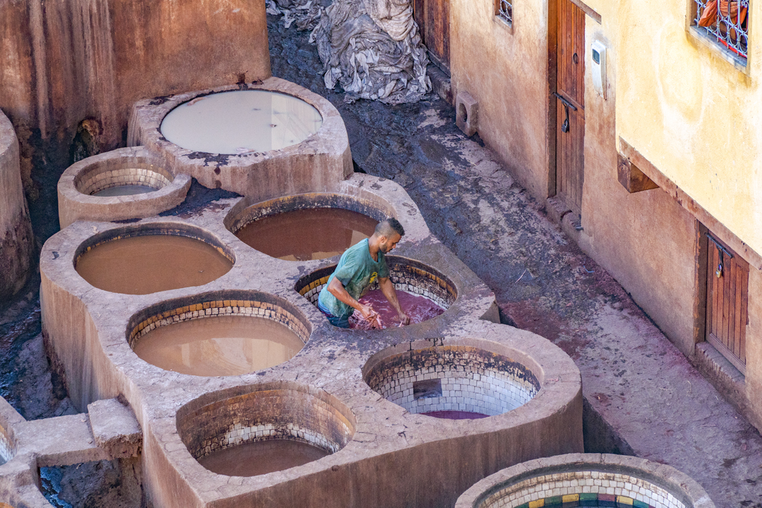 The Fez Tanneries. The only way to access the tanneries is through one of the many leather shops that have an open-air terrace.