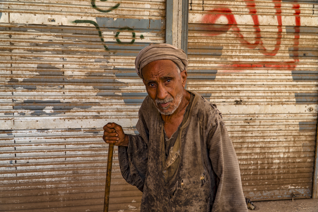 How Selfies Diminish Travel. This gentleman gladly posed and even staged a mock fight for me while we were exploring Qena, Egypt. We wanted to buy him some new clothes but he disappeared as quickly as he arrived.