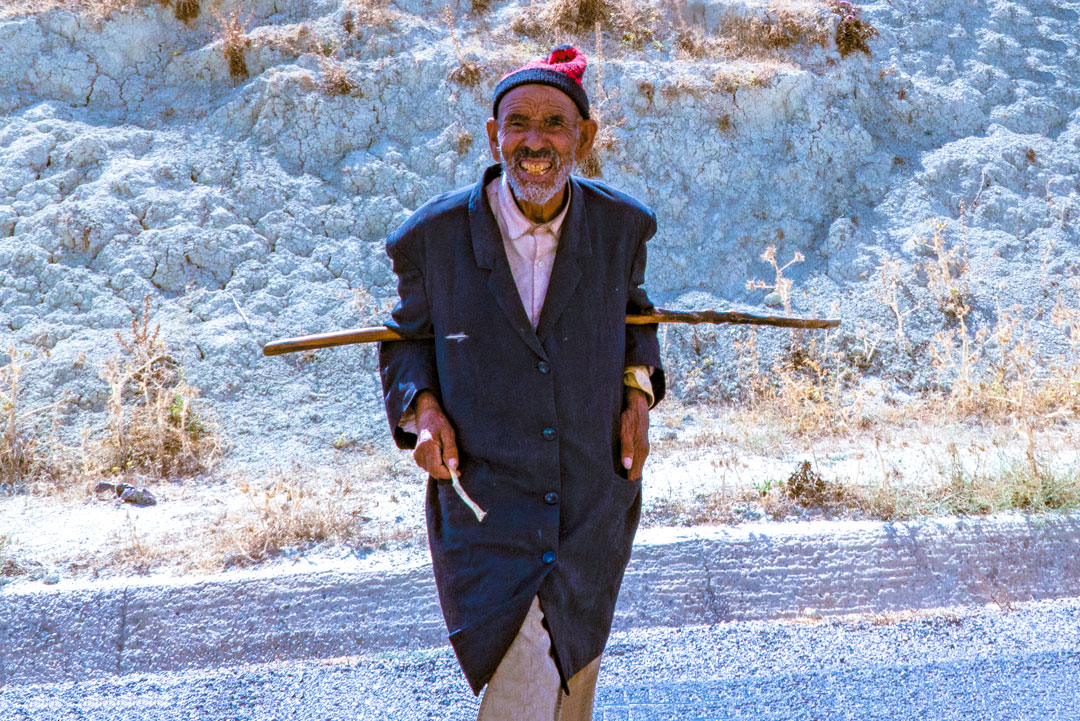 Fight Poverty Through Travel.  Man walking on the highway between Fes and Chefchaouen, Morocco. Were you aware that close to half of all people in developing countries suffer at any given time from health problems caused by water and sanitation deficits?