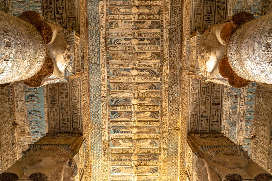 On the ceiling at Hathor Temple, the sun goddess seen here has raised arms covered in feathers which are figuratively used to support the ceiling.