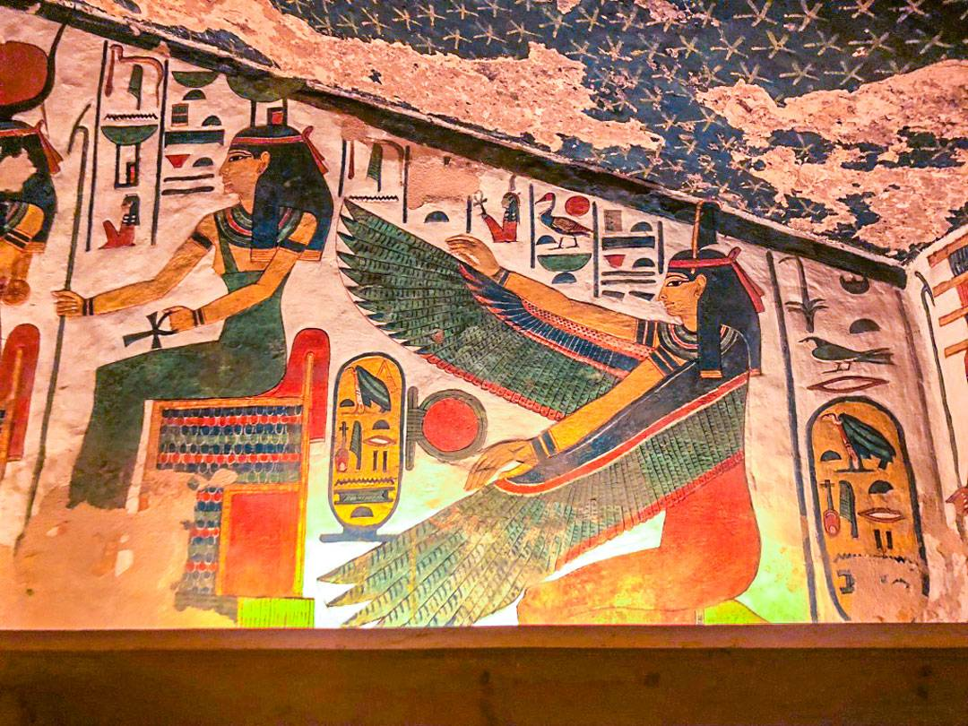 Photos of Nefertari's Tomb. Maat is seated here with arms with ostrich feathers. Maat was the goddess of truth, balance, order, harmony, law, morality, and justice.
