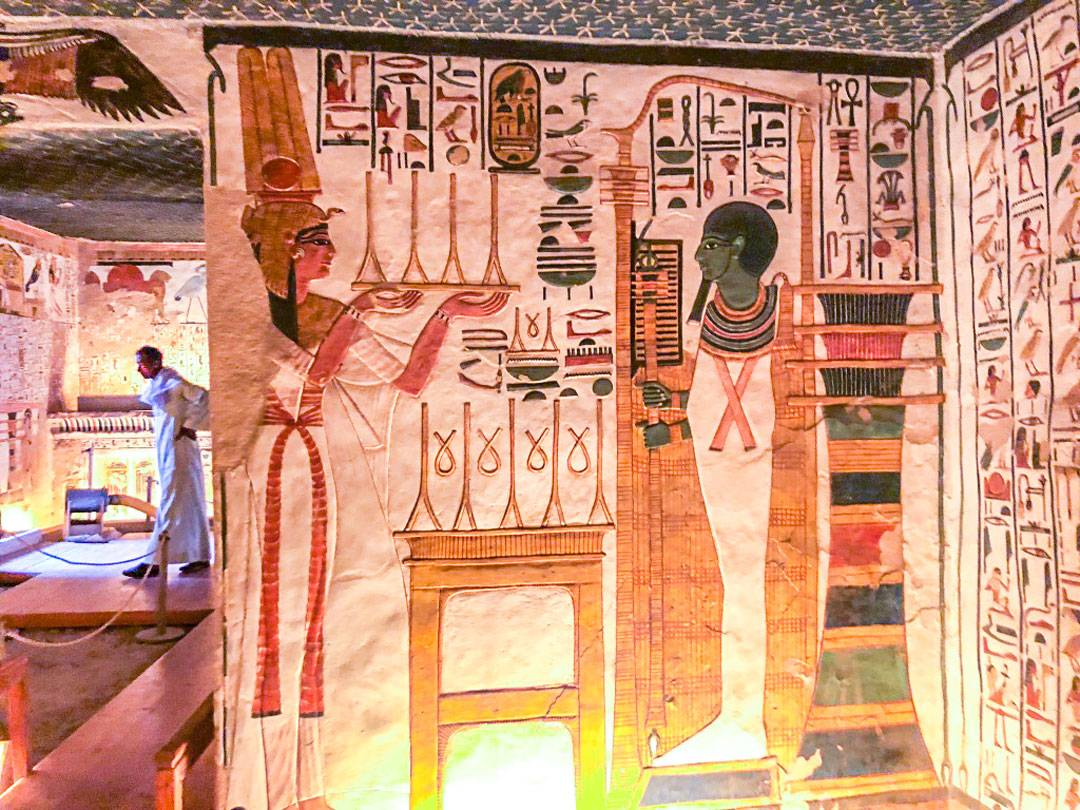 Photos of Nefertari's tomb. Seen to the left is one guard who is pacing back and forth. In front of him is the tomb entrance.