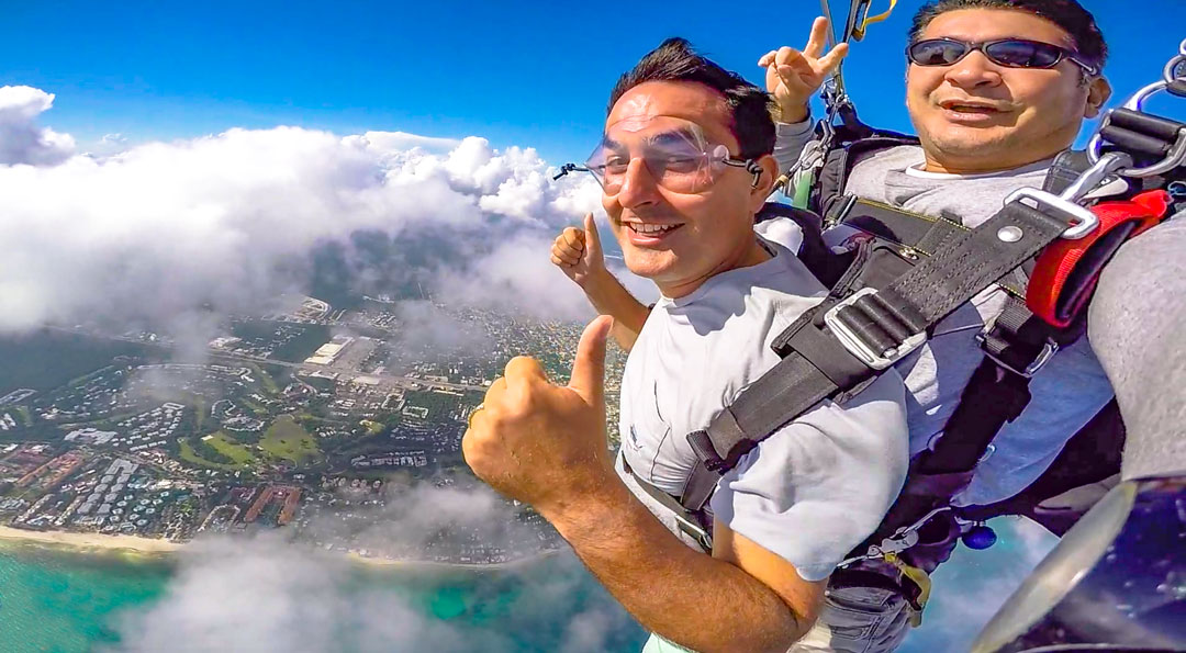 Playa del Carmen Skydiving. Once the chute opened, I knew I could relax. Then all the fears I had evaporated and the stress left my body in the form of laughter.