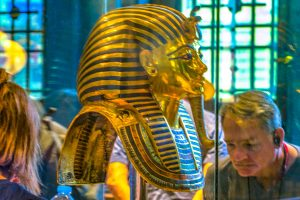 The gold death mask of King Tut from 1323 BC in the Egyptian Museum in Cairo. X-rays reveal it contains two alloys of gold: a lighter 18.4 karat shade for the face and neck, and 22.5 karat gold for the remainder.