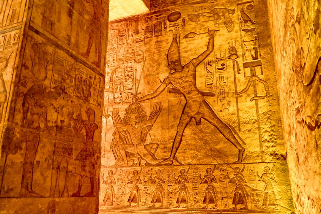 Abu Simbel Travel Guide. This relief shows a victorious King Ramses II killing an enemy.