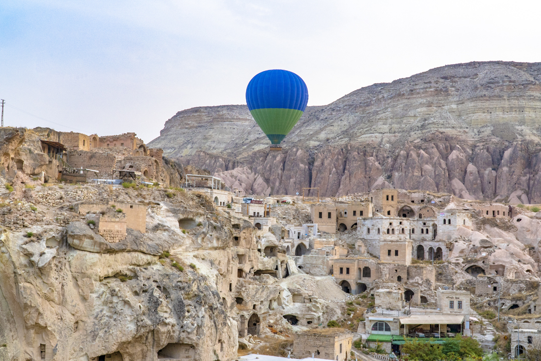 The Azure Cave Suites can be seen just below to the right of this hot air balloon.