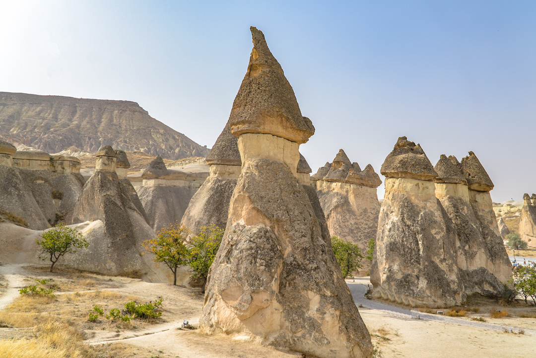 Fairy chimneys in Monk Valley. These chimneys were formed from volcanic eruptions millions of years ago. The hard rocks formed from the eruption eventually eroded due to wind and water leaving these peculiar structures.