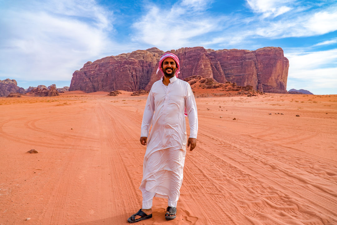 Bedouin tour in the Wadi Rum desert. Salem's brother, our bedouin guide and host, poses for a picture during our jeep tour. This is the spot where Lawrence of Arabia was filmed.