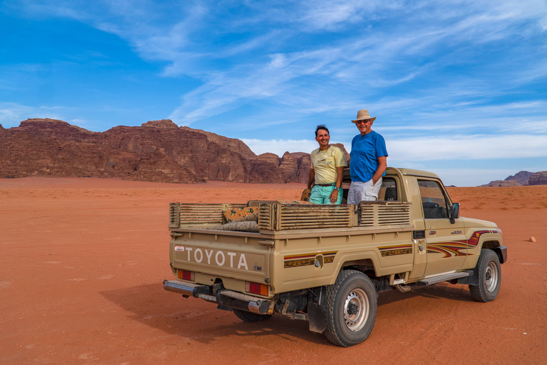 Bedouin tour in the Wadi Rum desert. Allan and I stand atop the flatbed during our jeep tour.