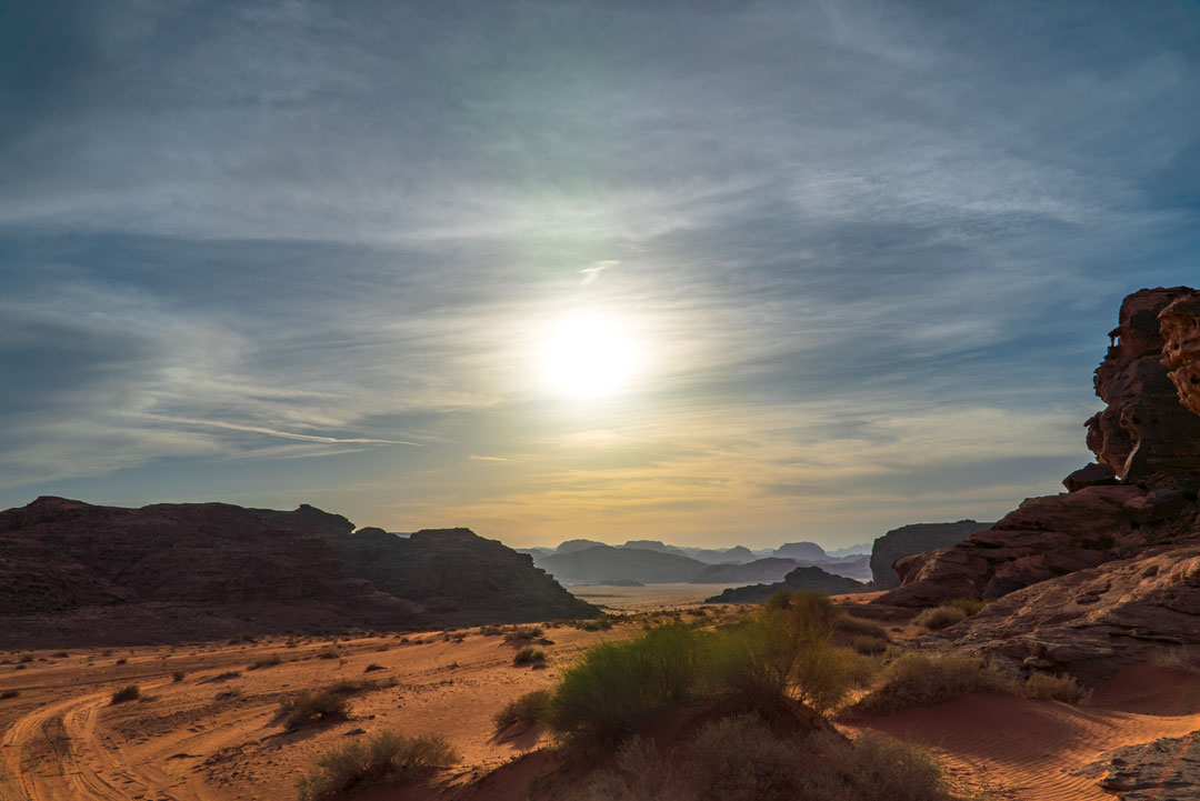 Bedouin tour in the Wadi Rum desert. The sun is setting as we approach camp after our jeep tour.