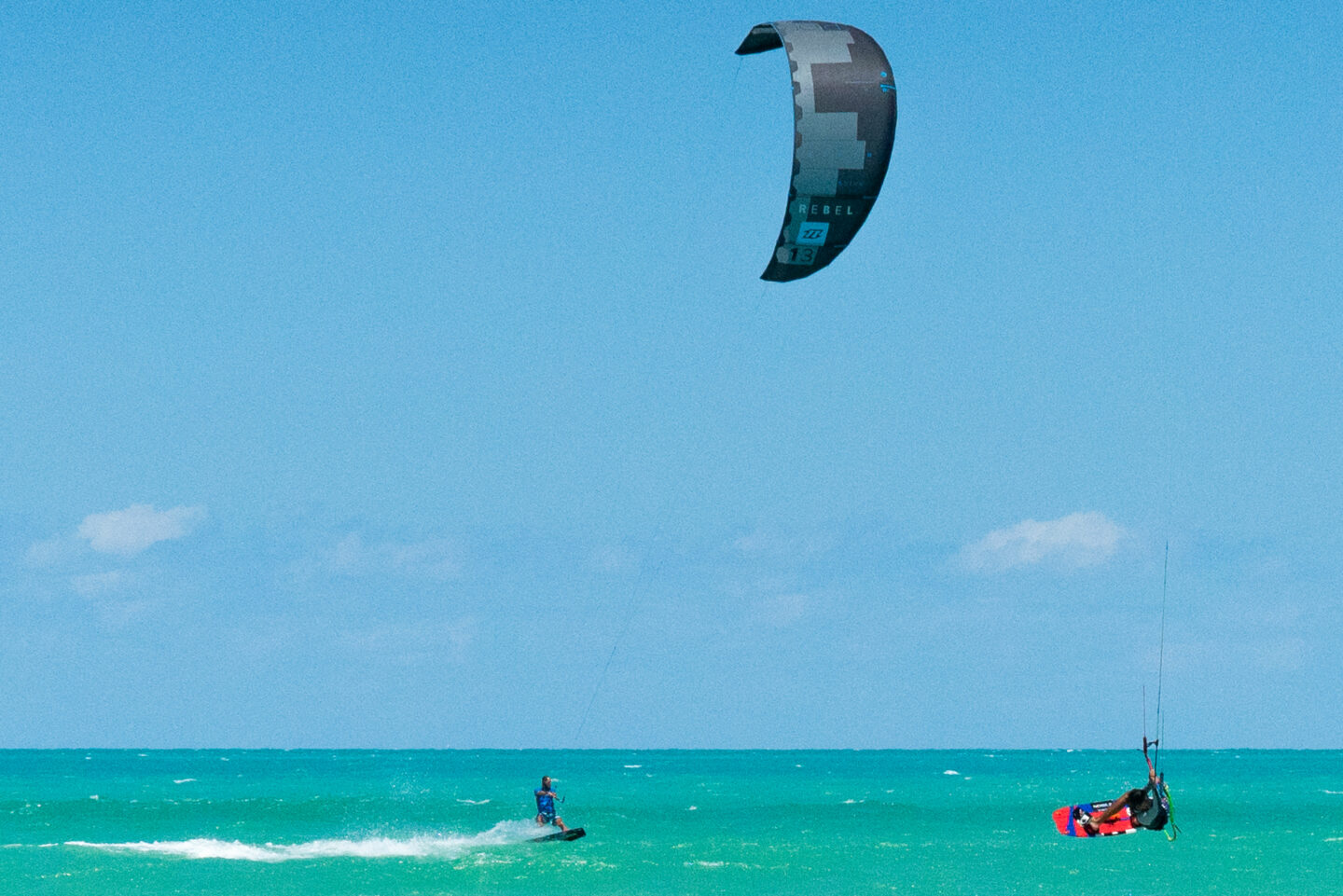 Kite Surfing in El Cuyo. El Cuyo is one of the best places to learn kiteboarding due to the shallow waters.